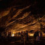 People dancing in a dark cave