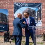 Mayor Hancock and a friend share a handshake and hug at the Hooper Groundbreaking event