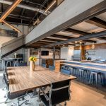 A contemporary office kitchen and meeting space