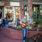 A man playing guitar on Pearl Street in Boulder, Colorado