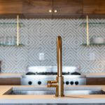 A detail shot of a contemporary kitchen and faucet