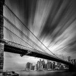 A time lapse image of the Brooklyn Bridge