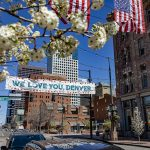 "A photograph of the ""we love you denver"" Larimer Square banners"