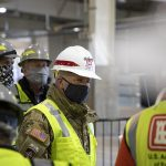 An army corps of engineers general wearing PPE and a facemask
