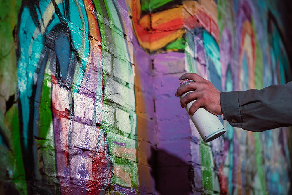 painting a wall with spray paint